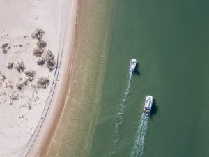 drone photo of two boats in the water