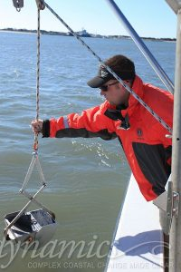Man operating sonar equipment