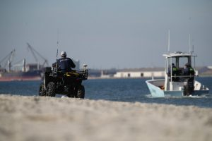 surveyors on ATV and research vessel