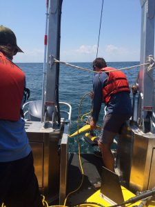 surveyors deploy a sidescan sonar
