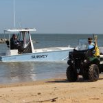 survey vessel and ATV on beach